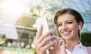 Attractive young business woman with smart phone in the city